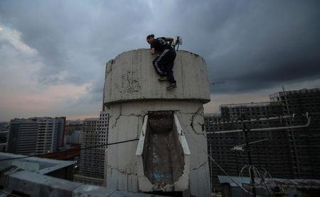 Vad Him of Rudex team climbs up a structure on a rooftop in Moscow, Russia, August 14, 2017.  REUTERS/Maxim Shemetov