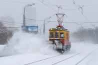 A tram removes snow from a track in Moscow