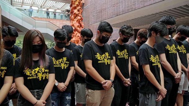 PHOTO: University students observe one minute silence to mourn those killed in the 1989 Tiananmen crackdown, in front of the 'Pillar of Shame' statue at the University of Hong Kong, June 4, 2021. (Kin Cheung/AP)