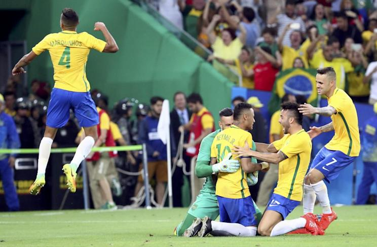 Members of the Brazilian men's soccer team celebrate after beating Germany in a shootout to win Olympic gold on Saturday. (Getty)