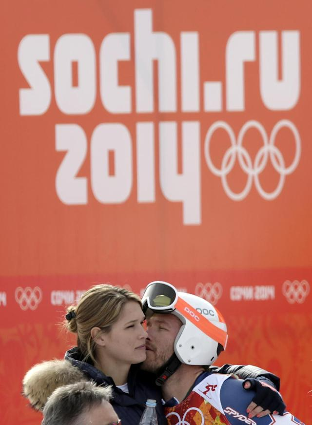 United States' Bode Miller kisses his wife Morgan after his finish in the first run of the men's giant slalom at the Sochi 2014 Winter Olympics, Wednesday, Feb. 19, 2014, in Krasnaya Polyana, Russia.(AP Photo/Gero Breloer)