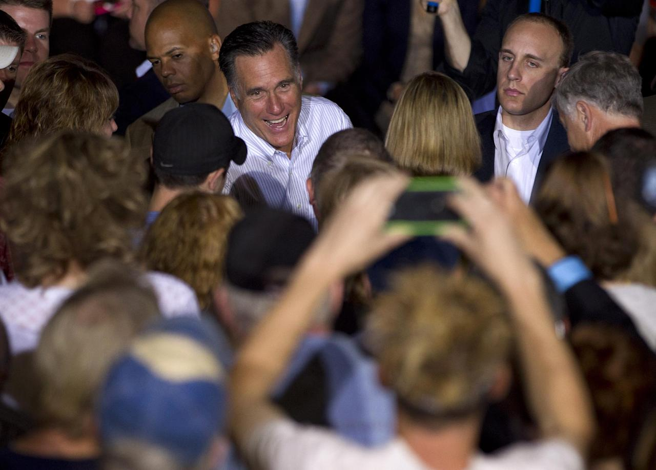 Republican presidential candidate, former Massachusetts Gov. Mitt Romney shakes hands during a campaign stop at Weatherly Casting Company in Weatherly, Pa., Saturday, June 16, 2012. (AP Photo/Evan Vucci)