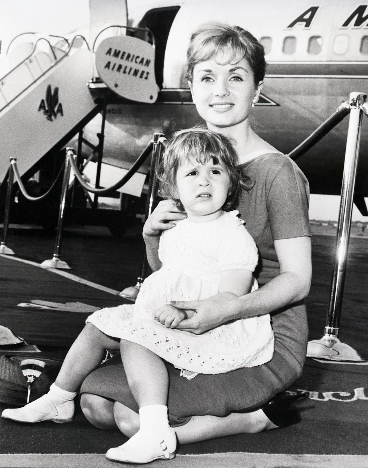 The mother and daughter prepare to board an American Airlines flight at LaGuardia Airport in June 1959.