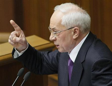 Ukraine's Prime Minister Azarov gestures during a session of the parliament in Kiev