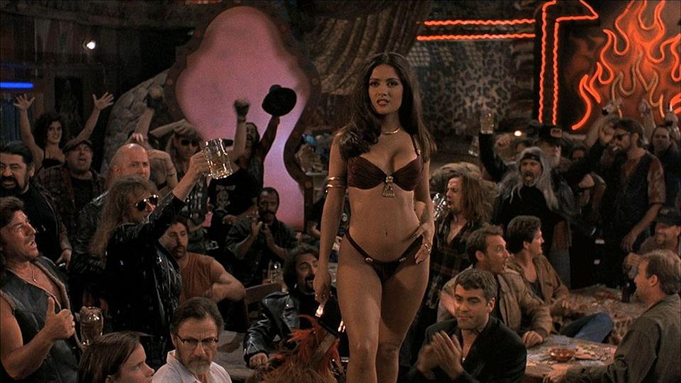 <p>Oh, hey, Salma Hayek! Her stint in this sexy burgundy push-up suit in the 1996 movie <em>Dusk Till Dawn</em> inspired a host of bra-like suits that year.</p>