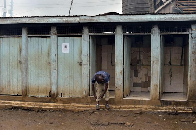 <p>A public toilet in the slum of Kibera, Nairobi. (Photo: Simon Maina/AFP/Getty Images) </p>