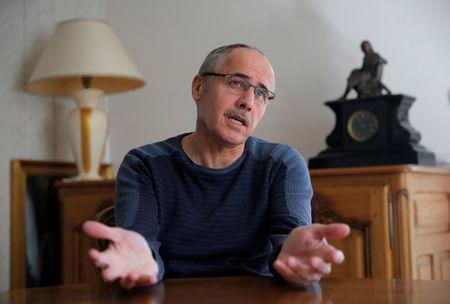 Jean-Marc Fleury, opponent to the project of an underground nuclear waste disposal of the French National Radioactive Waste Management Agency ANDRA in the village of Bure called CIGEO, talks to Reuters journalists during an interview at his home in Verney, France, April 6, 2018. Picture taken April 6, 2018. REUTERS/Vincent Kessler