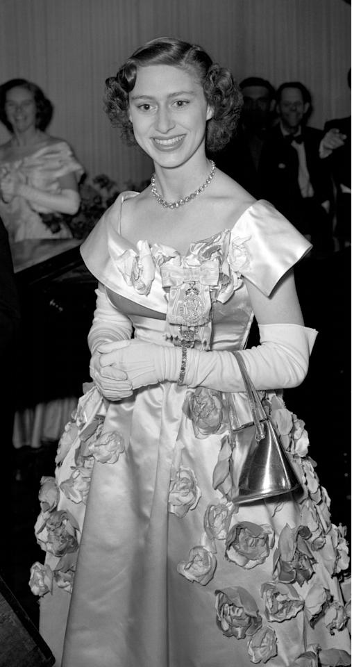 <p><b>Wearing a rose-adorned gown to a ball given by the Victoria League at the Hurlingham Club.<em> [Photo: PA]</em> </b></p>