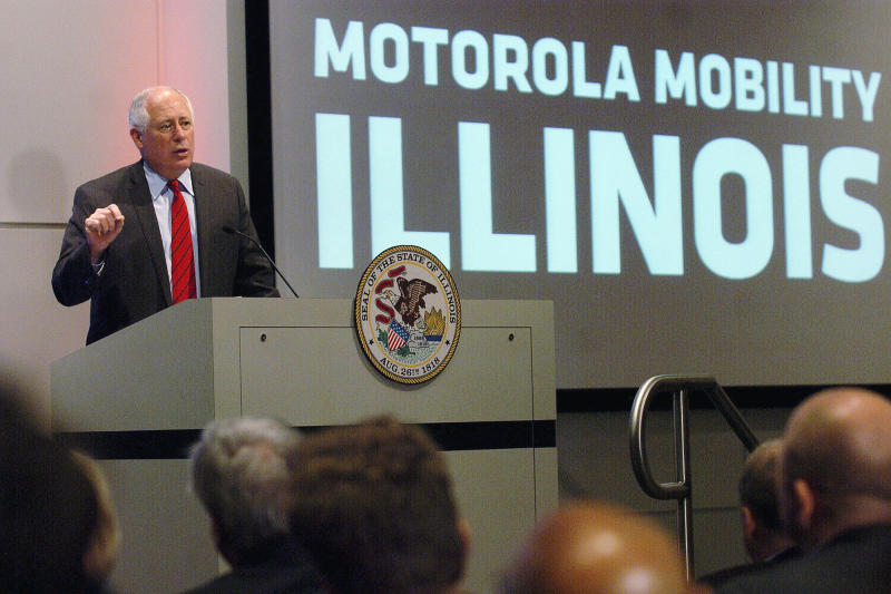 FILE - In this May 6, 2011 file photo, Illinois Gov. Pat Quinn announces to Motorola employees that the Motorola Mobility Inc. corporate headquarters will stay in Libertyville, Ill. Google Inc. on Monday, Aug. 13, 2012 announced plans to cut 4,000 jobs from Motorola Mobility, with 700 coming from operations in Illinois. In Illinois it means the company will lose the tax credits it receives from the state. Earlier this year, the Illinois Legislature agreed to give Motorola Mobility more than $100 million in state tax credits if it maintained a work force of at least 2,500 in the state. (AP Photo/Daily Herald, Bob Chwedyk, File)   MANDATORY CREDIT, MAGS OUT, TV OUT