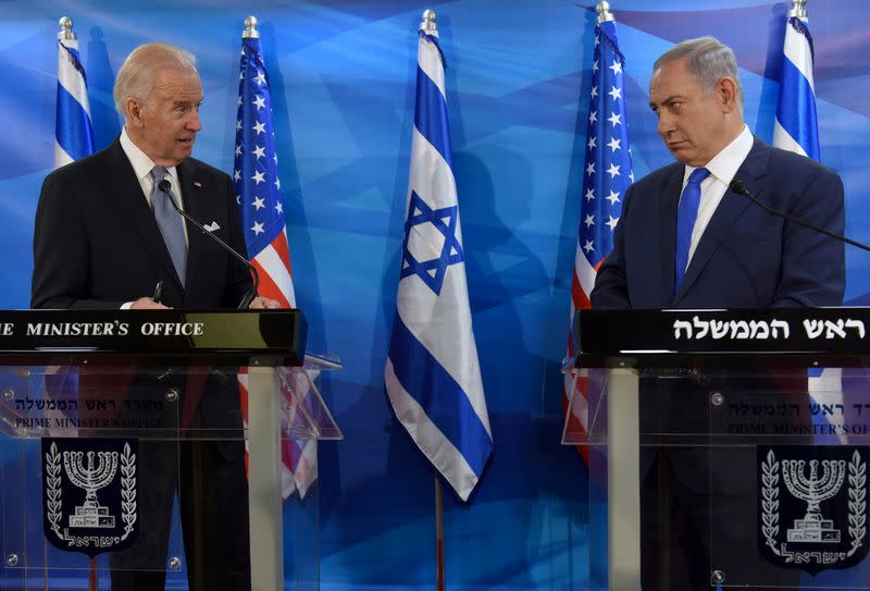 FILE PHOTO: U.S. Vice President Biden and Israeli Prime Minister Netanyahu look at each other as they deliver joint statements during their meeting in Jerusalem