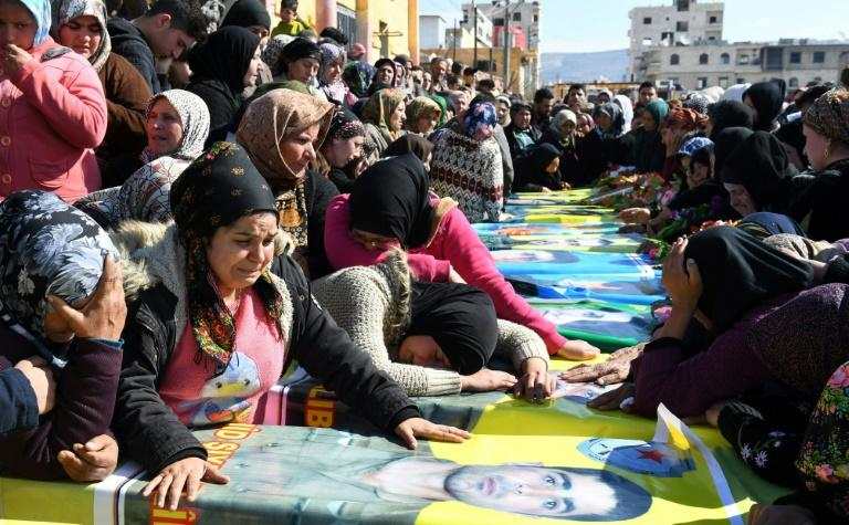Syrian Kurds attend a funeral ceremony on February 18, 2018 in the northern town of Afrin for Kurdish YPG fighters reportedly killed in clashes on the border with Turkey
