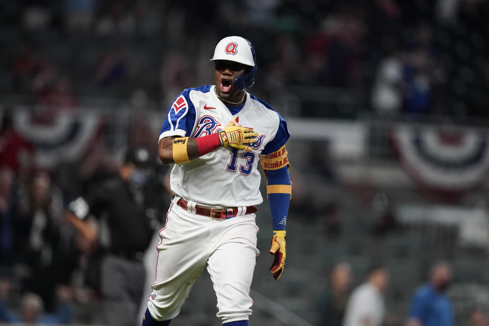 Atlanta Braves' Ronald Acuna Jr. celebrates a homer run against Miami. (AP Photo/Brynn Anderson)