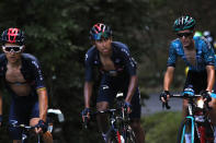 Colombia's Egan Bernal, center, climbs Grand Colombier during the stage 15 of the Tour de France cycling race over 174 kilometers (108 miles), with start in Lyon and finish in Grand Colombier, Sunday, Sept. 13, 2020. (AP Photo/Christophe Ena)