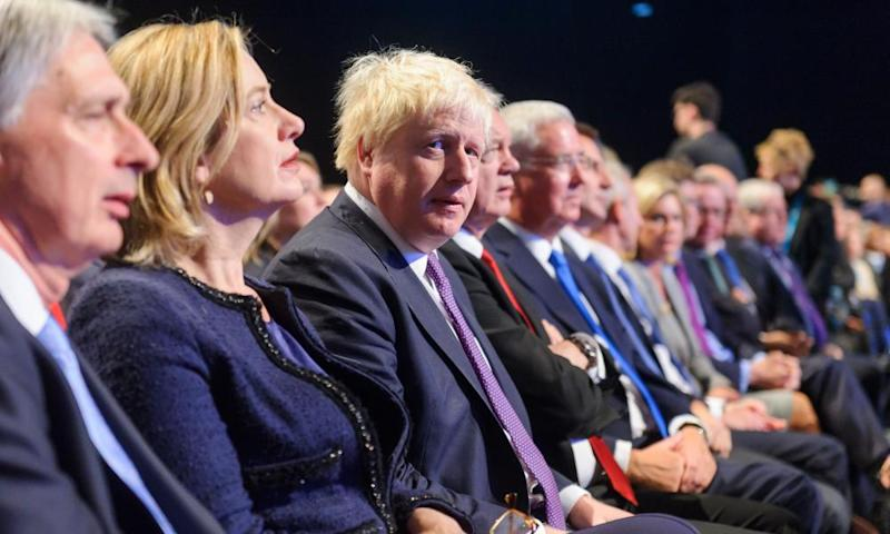 Boris Johnson, centre, looking at camera at the Conservative party conference