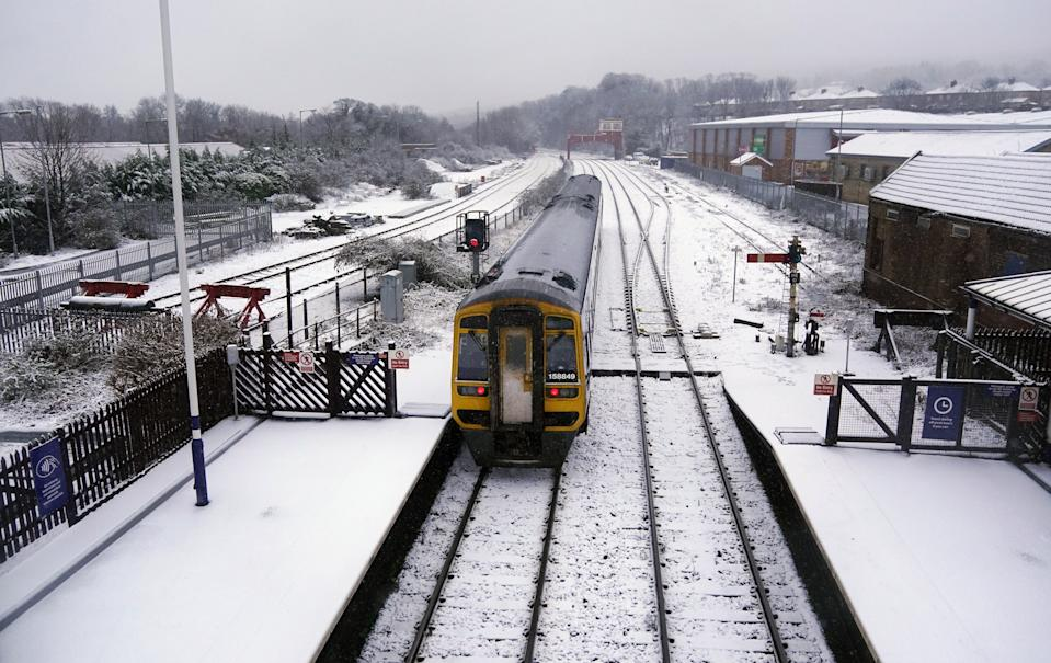 A train arrives at Hexham train station, Northumberland. Heavy snow and freezing rain is set to batter the UK this week, with warnings issued over potential power cuts and travel delays. (Photo by Owen Humphreys/PA Images via Getty Images)