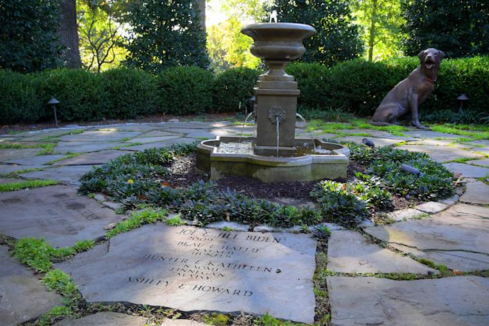 The Bidens added the Family Heritage Garden of the Vice President, where all occupants and their family members, including pets, are memorialized on the stone pavers around a fountain. In this photo from Oct. 28, 2016, a fiberglass replica of a bronze dog by artist Charles Parks is on loan and wears the collar of the Biden's dog, Champ. (Photo: The Washington Post via Getty Images)
