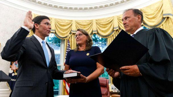 PHOTO: Mark Esper, left, is sworn in as the Secretary of Defense by Supreme Court Justice Samuel Alito, right, as is wife Leah Esper holds the Bible, during a ceremony in the Oval Office at the White House in Washington, July 23, 2019. (Carolyn Kaster/AP)
