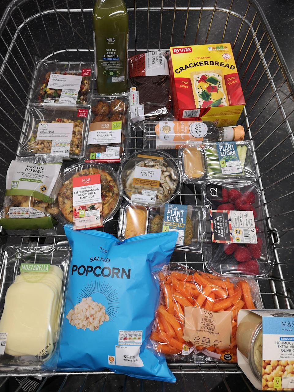 """<p>With the warmer weather comes a plethora of shop-made and ready-to-go picnic staples from your favourite supermarkets (<a href=""""https://www.marksandspencer.com/"""" rel=""""nofollow noopener"""" target=""""_blank"""" data-ylk=""""slk:Marks and Spencer"""" class=""""link rapid-noclick-resp"""">Marks and Spencer</a>, we're looking at you), prepared for you to enjoy in the park, on the beach or from your living room sofa—whatever you'd prefer.</p><p>Before you dive in and spend your hard earned cash on not so nutrient dense foods, picnics don't have to totally derail your nutrition. Far from it, as registered nutritionist and food expert Jenna Hope (@jennahopenutrition) is here to prove.</p><p>Women's Health sent Hope into her local M&S to share what she'd buy for a picnic with friends. </p><p>Keep scrolling for her top picks.</p>"""