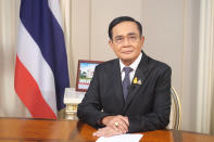 In this photo released by Government House, Thai Prime Minister Prayuth Chan-ocha sits in his office at Government House in Bangkok, Thailand, Wednesday, Oct. 21, 2020. Prayuth on Wednesday pleaded with his countrymen to resolve their political differences through Parliament, as student-led protests seeking to bring his government down continued for an eighth straight day. (Government House via AP)