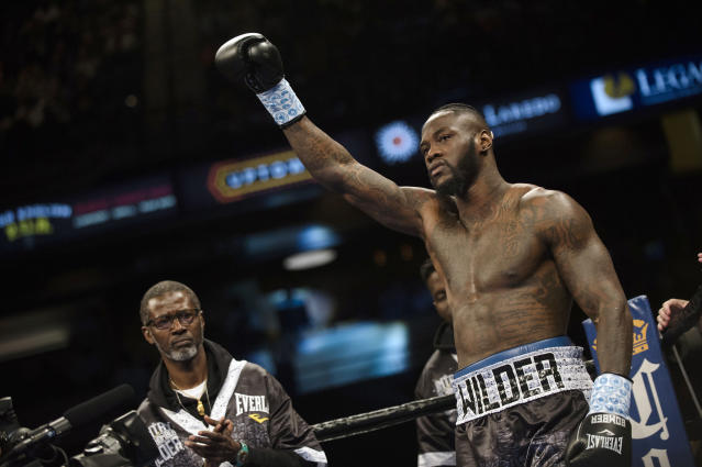A Joshua-Wilder fight in Las Vegas with the four major belts on the line would create a nearly unprecedented scene at T-Mobile. (AP)