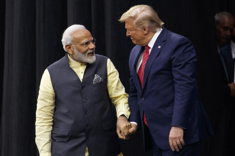 "President Donald Trump arrives to speak at the ""Howdy Modi: Shared Dreams, Bright Futures"" event with Indian Prime Minister Narendra Modi at NRG Stadium, Sunday, Sept. 22, 2019, in Houston. (AP Photo/Evan Vucci)"