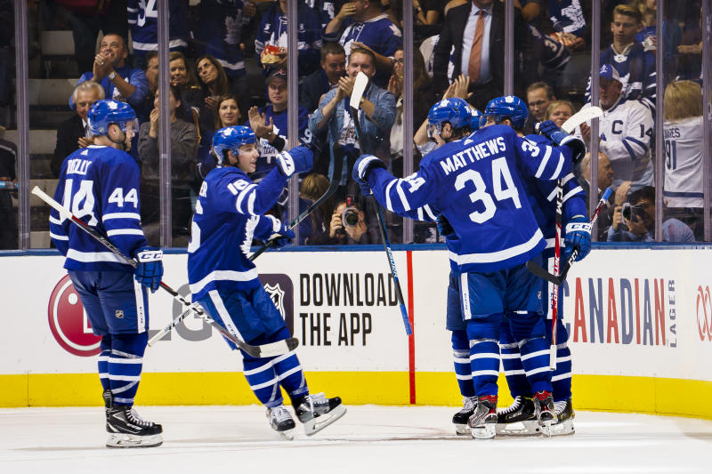 TORONTO, ON - OCTOBER 2: Auston Matthews #34 of the Toronto Maple Leafs celebrate this goal with teammates John Tavares #91,Mitchell Marner #16, Morgan Rielly #44, and Andreas Johnsson #18 against the Ottawa Senators during the second period at the Scotiabank Arena on October 2, 2019 in Toronto, Ontario, Canada. (Photo by Mark Blinch/NHLI via Getty Images)