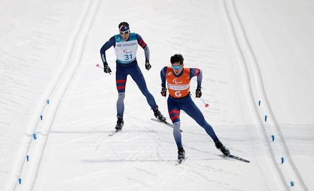 Cross-Country Skiing - Pyeongchang 2018 Winter Paralympics - Men's 20km Free - Visually Impaired - Alpensia Biathlon Centre - Pyeongchang, South Korea - March 12, 2018 - Thomas Clarion of France and his guide. REUTERS/Carl Recine