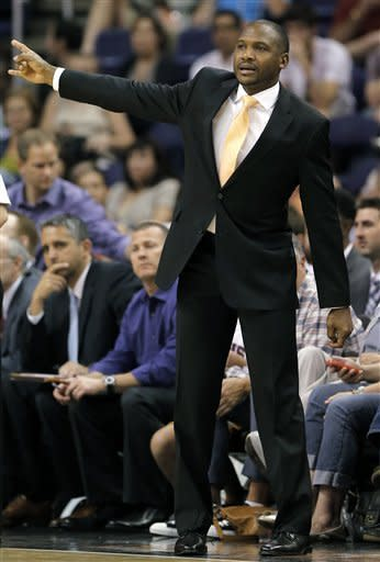 Phoenix Suns head coach Lindsey Hunter yells to his team during the first half of an NBA basketball game against the Brooklyn Nets, Sunday, March 24, 2013, in Phoenix. (AP Photo/Matt York)