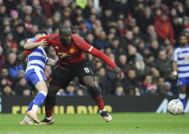 Manchester United's Romelu Lukaku challenge for the ball with Reading's player during the English FA Cup third round soccer match between Manchester United and Reading at Old Trafford in Manchester, England, Saturday, Jan. 5, 2019. (AP Photo/Rui Vieira)