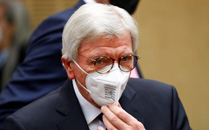 Hesse's State Premier Volker Bouffier wears a face mask as he attends the 1000th session  of the upper house of Parliament, the Bundesrat, on February 12, 2021 in Berlin. (Photo by FABRIZIO BENSCH / POOL / AFP) (Photo by FABRIZIO BENSCH/POOL/AFP via Getty Images) - FABRIZIO BENSCH/AFP