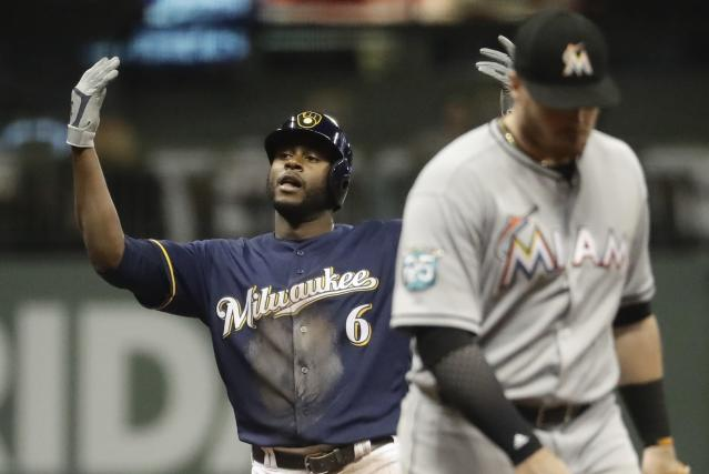 Milwaukee Brewers' Lorenzo Cain reacts after hitting a double during the third inning of a baseball game against the Miami Marlins Thursday, April 19, 2018, in Milwaukee. (AP Photo/Morry Gash)