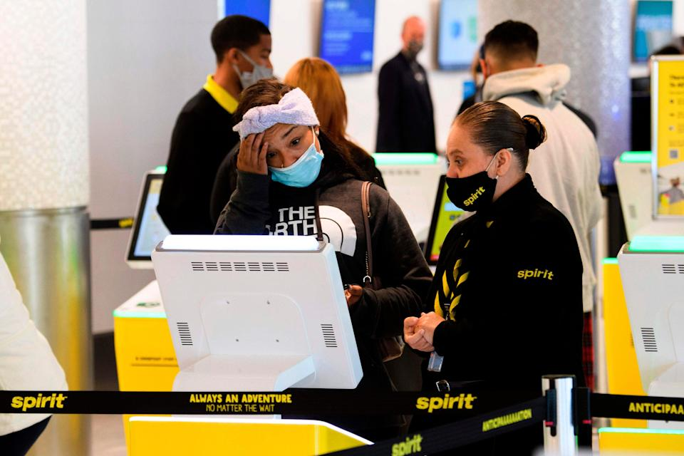 File photo of a passenger checking into Spirit Airlines flight  (AFP via Getty Images)