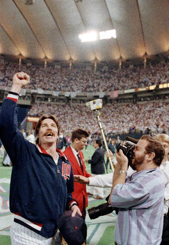 FILE - In this Oct. 26, 1991, file photo, Minnesota Twins pitcher Jack Morris, left, celebrates after the Twins won the World Series championship by defeating the Atlanta Braves 1-0 in 10 innnigs in Game 7 in Minneapolis, Minn., Sunday, Oct. 26, 1991. Morris pitched all 10 innings in the game and was named Most Valuable Player of the series. (AP Photo/Mark Duncan, File)