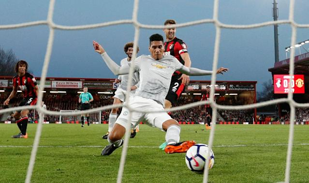 "Soccer Football - Premier League - AFC Bournemouth vs Manchester United - Vitality Stadium, Bournemouth, Britain - April 18, 2018 Manchester United's Chris Smalling scores their first goal Action Images via Reuters/John Sibley EDITORIAL USE ONLY. No use with unauthorized audio, video, data, fixture lists, club/league logos or ""live"" services. Online in-match use limited to 75 images, no video emulation. No use in betting, games or single club/league/player publications. Please contact your account representative for further details."