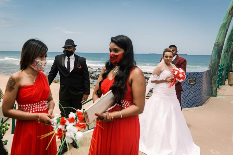 A masked wedding party celebrates in Durban, South Africa