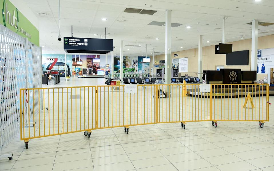 The empty arrivals terminal at the Gold Coast Airport is closed off by barriers in a photo dated 10 July 2020 - ALBERT PEREZ/EPA-EFE/Shutterstock