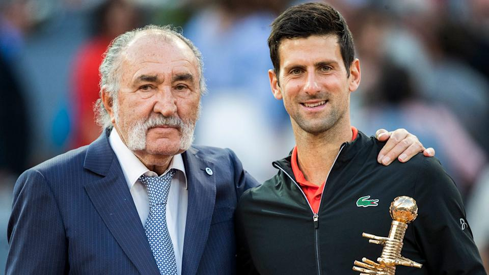 Madrid Open owner Ion Tiriac presents Novak Djokovic with the 2019 winner's trophy. Pic: Getty