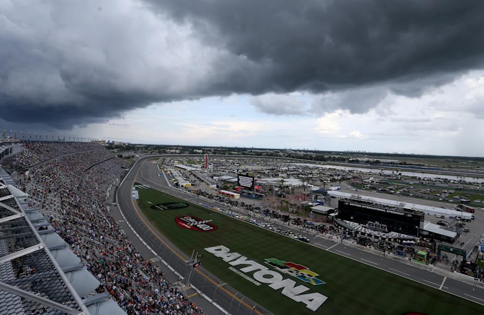 DAYTONA BEACH, FLORIDA - JULY 07: Storm clouds and weather brings the cars to pit road during the Monster Energy NASCAR Cup Series Coke Zero Sugar 400 at Daytona International Speedway on July 07, 2019 in Daytona Beach, Florida. (Photo by Brian Lawdermilk/Getty Images)
