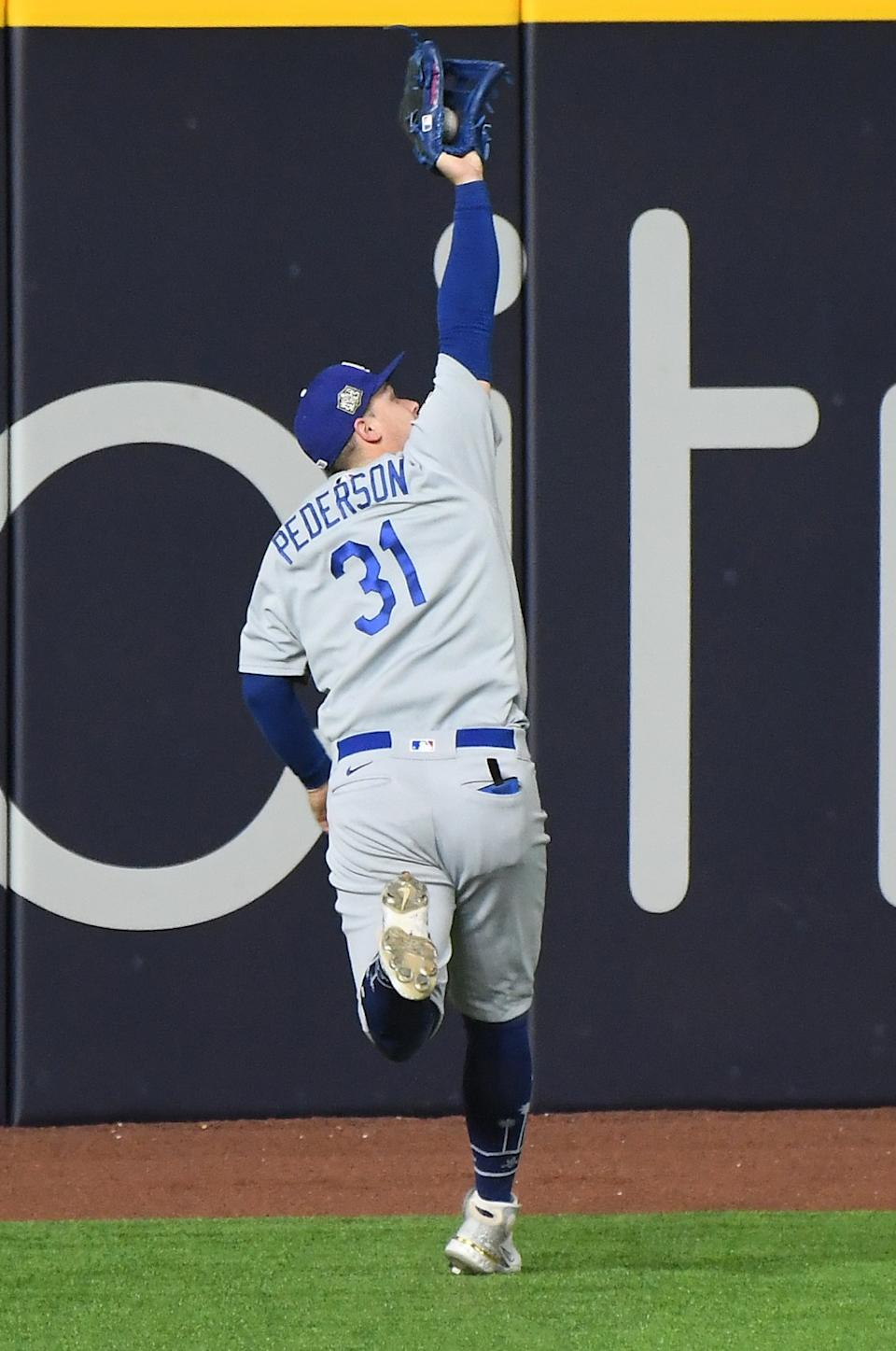 Dodgers left fielder Joc Pederson makes a catch off the bat of Rays' Joey Wendle during the seventh inning.