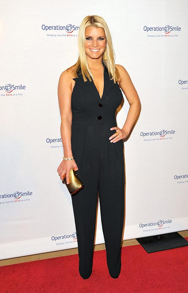 """Despite all of her recent woes -- including the loss of her beloved pet pooch and her breakup with Tony Romo -- Jessica Simpson slapped on a smile and made a triumphant return to the red carpet at Operation Smile's 8th annual gala in a sleek and chic jumpsuit and straightened locks. Jason Merritt/<a href=""""http://www.gettyimages.com/"""" target=""""new"""">GettyImages.com</a> - October 2, 2009"""