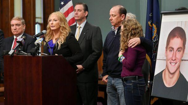 Jim and Evelyn Piazza, right, stand by as Centre County District Attorney Stacy Parks Miller, second from left, announces the results of an investigation into the death of their son Timothy Piazza during a press conference, May 5, 2017, in Bellefonte, Pa. (Abby Drey/Centre Daily Times via AP Photo)