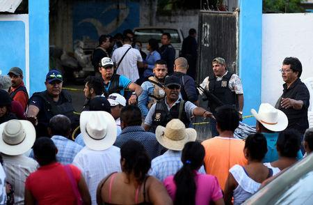 Policemen guard a crime scene where mayoral candidate Santana Cruz Bahena was gunned down at his home in the municipality of Hidalgotitlan, in the state of Veracruz, Mexico November 20, 2017. REUTERS/Angel Hernandez