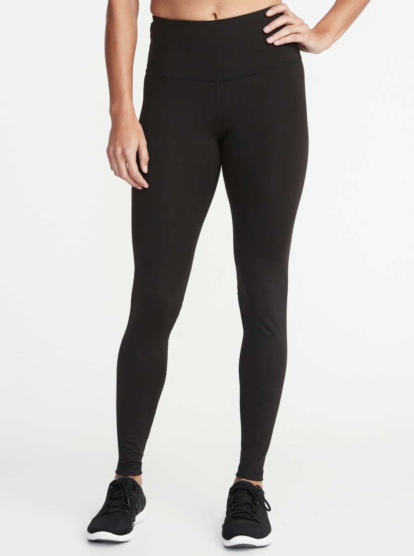 "I hope this round-up starts and ends with my recommendation, because there's only one BEST pair of black leggings. I don't care where you're going or what you're doing, if you're wearing black leggings and they're not Old Navy's High-Waisted Compression leggings, then you could do better. I wear the <a href=""https://oldnavy.gap.com/browse/product.do?pid=353173002"" rel=""nofollow noopener"" target=""_blank"" data-ylk=""slk:Crops"" class=""link rapid-noclick-resp"">Crops</a> from spring through fall, the <a href=""https://oldnavy.gap.com/browse/product.do?pid=711861002"" rel=""nofollow noopener"" target=""_blank"" data-ylk=""slk:Full-Length Leggings"" class=""link rapid-noclick-resp"">Full-Length Leggings</a> in winter, and the <a href=""https://oldnavy.gap.com/browse/product.do?pid=452136032"" rel=""nofollow noopener"" target=""_blank"" data-ylk=""slk:7/8 Moto Leggings"" class=""link rapid-noclick-resp"">7/8 Moto Leggings</a> are my go-tos for the airport. Do you require a pocket? <a href=""https://oldnavy.gap.com/browse/product.do?pid=507362002"" rel=""nofollow noopener"" target=""_blank"" data-ylk=""slk:Here you go"" class=""link rapid-noclick-resp"">Here you go</a>. A pocket that zips? <a href=""https://oldnavy.gap.com/browse/product.do?pid=452133002"" rel=""nofollow noopener"" target=""_blank"" data-ylk=""slk:You're covered"" class=""link rapid-noclick-resp"">You're covered</a>. Want racing stripes? <a href=""https://oldnavy.gap.com/browse/product.do?pid=340897002"" rel=""nofollow noopener"" target=""_blank"" data-ylk=""slk:Have at it"" class=""link rapid-noclick-resp"">Have at it</a>. And you could probably buy all six of the aforementioned pairs for less than one pair from a boutique brand. I've written <a href=""https://www.glamour.com/story/best-workout-pants-under-30-dollars?mbid=synd_yahoo_rss"" rel=""nofollow noopener"" target=""_blank"" data-ylk=""slk:a full-length ode to the actual best leggings"" class=""link rapid-noclick-resp"">a full-length ode to the <em>actual</em> best leggings</a>—<em>the cut! the fabric! the fact that they never get funky!</em>—if you need more convincing, but hopefully you're busy adding to cart before all the women who know what's what beat you to 'em. —<em>Kim Fusaro, brand marketing director</em> $29, Old Navy. <a href=""https://oldnavy.gap.com/browse/product.do?pid=711861#pdp-page-content"" rel=""nofollow noopener"" target=""_blank"" data-ylk=""slk:Get it now!"" class=""link rapid-noclick-resp"">Get it now!</a>"