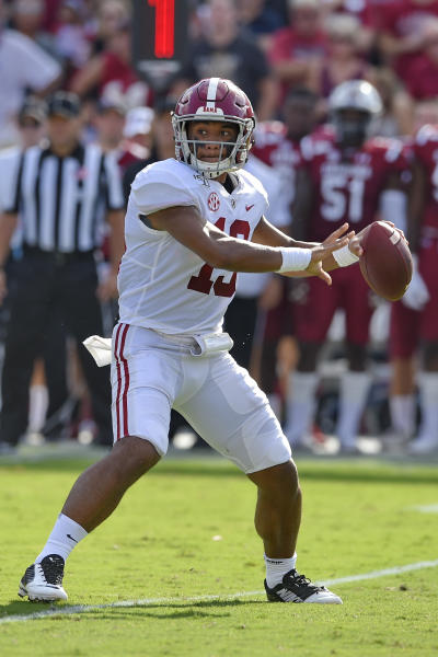 Alabama quarterback Tua Tagovailoa throws a pass during the first half of an NCAA college football game against South Carolina, Saturday, Sept. 14, 2019, in Columbia, S.C. (AP Photo/Richard Shiro)