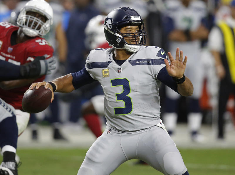 FILE - In this Sept. 30, 2018, file photo, Seattle Seahawks quarterback Russell Wilson (3) throws against the Arizona Cardinals during the first half of an NFL football game, in Glendale, Ariz. The most telling stat of how Seattle has changed is when looking at Wilsons numbers. In the first two games, he was sacked 12 times, completed just 59.4 percent of his throws and had a passer rating of 89.3. In the four games since, Wilson is completing 67 percent of his passes while attempting significantly fewer throws, has a passer rating of 116.0 and has been sacked seven times. (AP Photo/Ross D. Franklin, File)