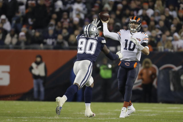 Chicago Bears quarterback Mitchell Trubisky (10) throws against Dallas Cowboys' Demarcus Lawrence (90) during the second half of an NFL football game, Thursday, Dec. 5, 2019, in Chicago. (AP Photo/Morry Gash)