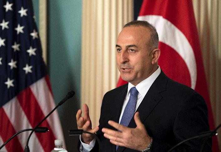 Turkish Foreign Minister Mevlut Cavusoglu makes a statement to the press at the US Department of State on April 21, 2015 in Washington, DC (AFP Photo/Brendan Smialowski)