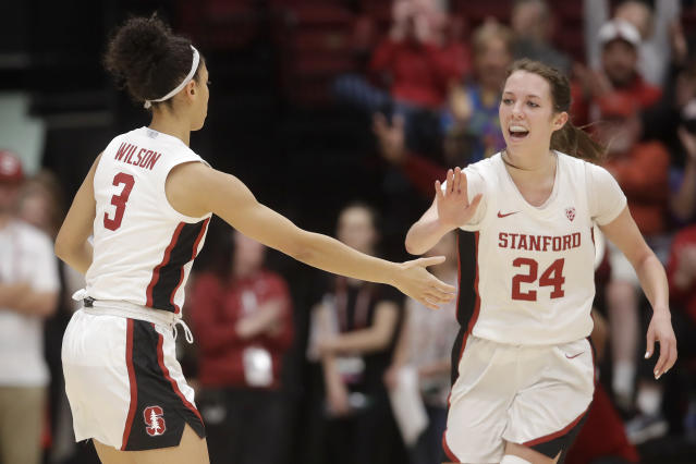 Stanford guard Anna Wilson (3) is congratulated by guard Lacie Hull (24) after scoring against Oregon State during the second half of an NCAA college basketball game in Stanford, Calif., Friday, Feb. 21, 2020. (AP Photo/Jeff Chiu)