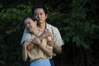 """This image released by A24 shows Yeri Han, foreground, and Steven Yeun in a scene from """"Minari."""" (Josh Ethan Johnson/A24 via AP)"""