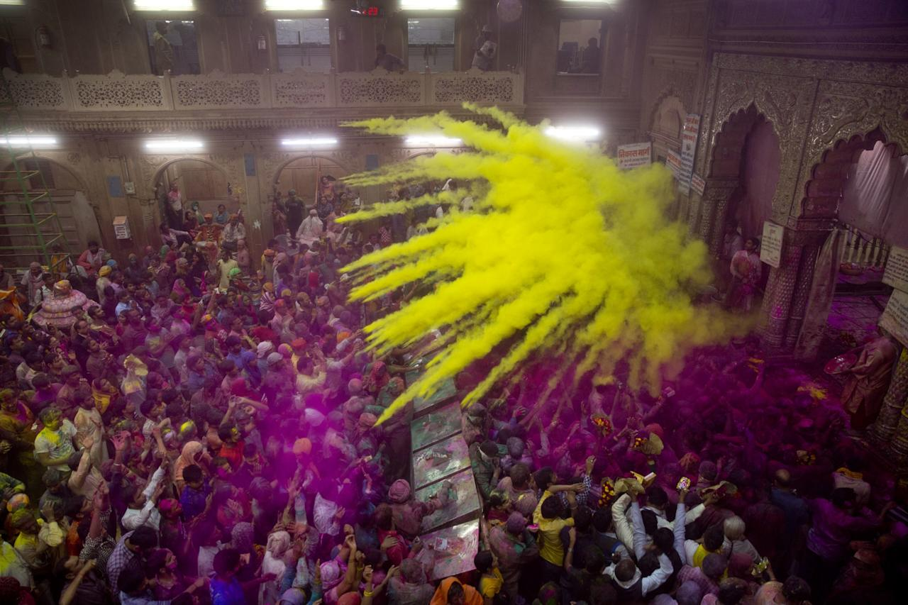 <p>Hindu devotees throw colored powder on each other inside Banke Bihari temple during Holi festival celebrations in Vrindavan, India, Wednesday, March 8, 2017. Holi, the festival of colors celebrates the arrival of spring among other things. (AP Photo/Manish Swarup) </p>